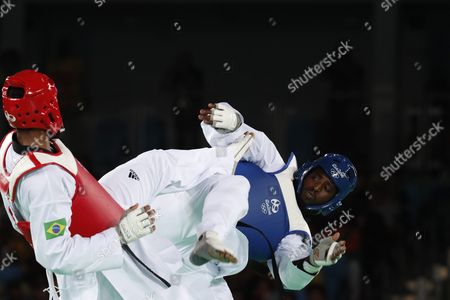 Maicon Siqueira of Brazil (red) and Mahama Cho of Great Britain (blue) in Action During the Men's +80kg Bronze Medal Bout of the Rio 2016 Olympic Games Taekwondo Events at the Carioca Arena 3 in the Olympic Park in Rio De Janeiro Brazil 20 August 2016 Brazil Rio De Janeiro