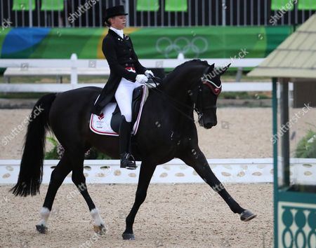 Agnete Kirk Thinggaard of Denmark with Her Horse Jojo Az Performs During the Dressage Individual Grand Prix Competition of the Rio 2016 Olympic Games Equestrian Events at the Olympic Equestrian Centre in Rio De Janeiro Brazil 10 August 2016 Brazil Rio De Janeiro