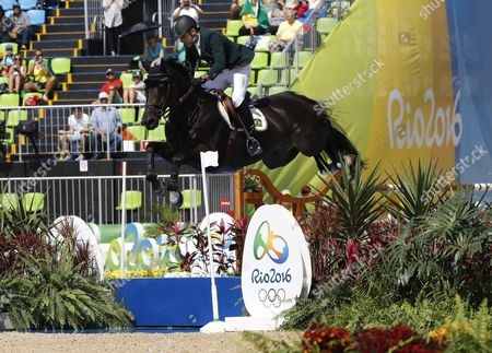 Stock Photo of Alvaro Doda De Miranda Riding Cornetto K Performs During the Jumping Individual 2nd Qualifier Competition of the Rio 2016 Olympic Games Equestrian Events at the Olympic Equestrian Centre in Rio De Janeiro Brazil 16 August 2016 Brazil Rio De Janeiro