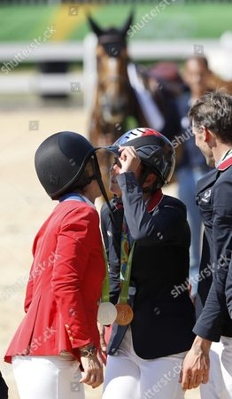 Sillver Medalist Elizabeth Madden of Usa (l) and Gold Medalist Penelope Leprevost of France (c) Congratulate Each Other During the Awards Ceremony in the Jumping Team Competition of the Rio 2016 Olympic Games Equestrian Events at the Olympic Equestrian Centre in Rio De Janeiro Brazil 17 August 2016 Brazil Rio De Janeiro
