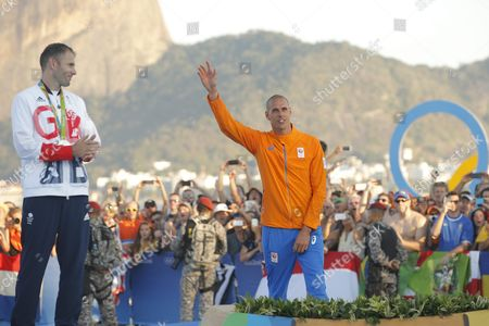 Gold Medalist Dorian Van Rijsselberghe (r) Celebrates As Silver Medalist Nick Dempsey of Great Britain (l) Looks on During the Awards Ceremony in the Men's Rs:x Class Race of the Rio 2016 Olympic Games Sailing Events at the Marina Da Gloria in Rio De Janeiro Brazil 14 August 2016 Brazil Rio De Janeiro