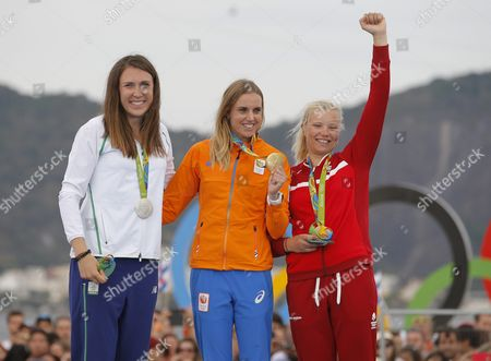 Gold Medalist Marit Bouwmeester of Netherlands (c) Silver Medalist Annalise Murphy of Ireland (l) and Bronze Medalist Anne-marie Rindom of Denmark (r) During the Award Ceremony in the Women Laser Radial Class of the Rio 2016 Olympic Games Sailing Events at the Marina Da Gloria in Rio De Janeiro Brazil 16 August 2016 Brazil Rio De Janeiro