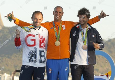 Gold Medalist Dorian Van Rijsselberghe (c) Silver Medalist Nick Dempsey of Great Britain (l) and Bronze Medalist Pierre Le Coq of France (r) Pose During the Awards Ceremony in the Men's Rs:x Class Race of the Rio 2016 Olympic Games Sailing Events at the Marina Da Gloria in Rio De Janeiro Brazil 14 August 2016 Brazil Rio De Janeiro