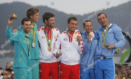 Sime Fantela and Igor Marenic of Croatia (c) Pose with Their Gold Medals on the Podium After Winning the Men's 470 Class Medal Race of the Rio 2016 Olympic Games Sailing Events at the Marina Da Gloria in Rio De Janeiro Brazil 18 August 2016 Fantela and Marenic Won Ahead of Second Placed Mathew Belcher and William Ryan of Australia (l) and Third Placed Panagiotis Mantis and Pavlos Kagialis of Greece (r) Brazil Rio De Janeiro