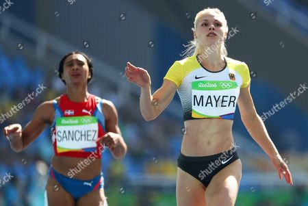 Mariely Sanchez (l) of the Dominican Republic and Lisa Mayer (r) of Germany Compete During the Women's 200m Heats of the Rio 2016 Olympic Games Athletics Track and Field Events at the Olympic Stadium in Rio De Janeiro Brazil 15 August 2016 Brazil Rio De Janeiro