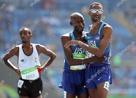 Bernard Lagat (c) and Hassan Mead (r) Both of the Usa React After Competing During the Men's 5000m Heats of the Rio 2016 Olympic Games Athletics Track and Field Events at the Olympic Stadium in Rio De Janeiro Brazil 17 August 2016 Brazil Rio De Janeiro
