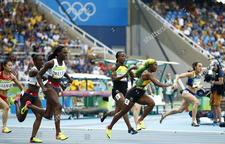 Veronica Campbell-brown (c-l) and Shelly-ann Fraser-pryce (c-r) of Jamaica Compete During the Women's 4x100m Relay Heats of the Rio 2016 Olympic Games Athletics Track and Field Events at the Olympic Stadium in Rio De Janeiro Brazil 18 August 2016 Brazil Rio De Janeiro
