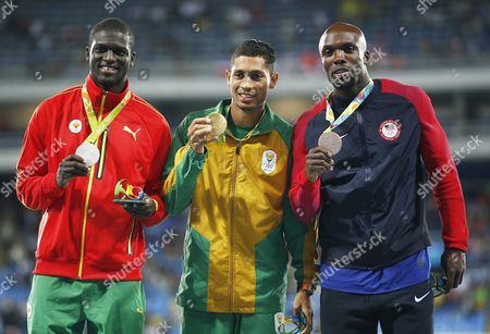 Gold Medalist Wayde Van Niekerk of South Africa is Flanked on the Podium by Silver Medalist Kirani James (l) of Grenada and Bronze Winner Lashawn Merritt of the Usa During the Medal Ceremony For the Men's 400m of the Rio 2016 Olympic Games Athletics Track and Field Events at the Olympic Stadium in Rio De Janeiro Brazil 15 August 2016 Brazil Rio De Janeiro