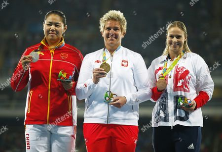 Stock Image of Gold Medalist Anita Wlodarczyk of Poland is Flanked on the Podium by Silver Medalist Wenxiu Zhang (l) of China and Bronze Winner Sophie Hitchon of Great Britain During the Medal Ceremony For the Women's Hammer Throw of the Rio 2016 Olympic Games Athletics Track and Field Events at the Olympic Stadium in Rio De Janeiro Brazil 15 August 2016 Brazil Rio De Janeiro