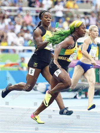 Veronica Campbell-brown (l) and Shelly-ann Fraser-pryce (r) of Jamaica Compete During the Women's 4x100m Relay Heats of the Rio 2016 Olympic Games Athletics Track and Field Events at the Olympic Stadium in Rio De Janeiro Brazil 18 August 2016 Brazil Rio De Janeiro