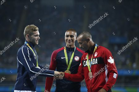 (l-r) Silver Medalist Kevin Mayer of France Gold Medalist Ashton Eaton of Usa and Bronze Medalist Damian Warner of Canada Smiles on the Podium During the Medal Ceremony For the Women's Decathlon Competition of the Rio 2016 Olympic Games Athletics Track and Field Events at the Olympic Stadium in Rio De Janeiro Brazil 19 August 2016 Brazil Rio De Janeiro