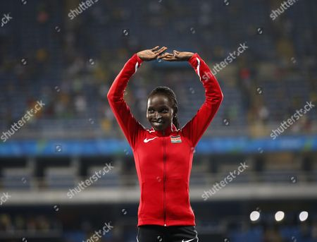 Gold Medalist Vivian Jepkemoi Cheruiyot of Kenya Smiles on the Podium During the Medal Ceremony For the Women's 5000m Final Race of the Rio 2016 Olympic Games Athletics Track and Field Events at the Olympic Stadium in Rio De Janeiro Brazil 19 August 2016 Brazil Rio De Janeiro