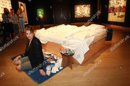 British Artist Tracy Emin Sits Next to Her Artwork 'My Bed' (1998) During the Preview For the 'Post-war and Contemporary Art' Auction at Christie's in London Britain 27 June 2014 the Auction Will Take Place on 01 July United Kingdom London