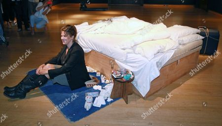 Stock Photo of British Artist Tracy Emin Sits Next to Her Artwork 'My Bed' (1998) During the Preview For the 'Post-war and Contemporary Art' Auction at Christie's in London Britain 27 June 2014 the Auction Will Take Place on 01 July United Kingdom London