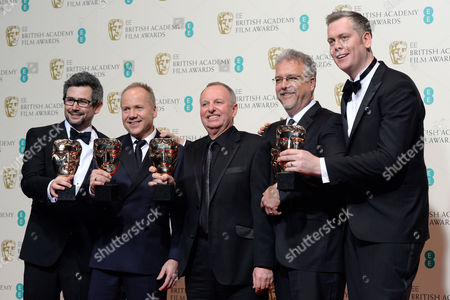 Sound Editors Producers and Mixers (l-r) Glenn Freemantle Skip Lievsay Christopher Benstead Niv Adiri and Chris Munro Pose in the Press Room After Winning the Best Sound Award For 'Gravity' at the 2014 Ee British Academy Film Awards Ceremony at the Royal Opera House in London Britain 16 February 2014 the Ceremony is Hosted by the British Academy of Film and Television Arts (bafta) United Kingdom London