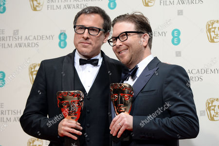 Us Writer Eric Warren Singer (r) and Film Director David O Russell (l) Pose in the Press Room After Winning the Best Original Screenplay Award For 'American Hustle' at the 2014 Ee British Academy Film Awards Ceremony at the Royal Opera House in London Britain 16 February 2014 the Ceremony is Hosted by the British Academy of Film and Television Arts (bafta) United Kingdom London