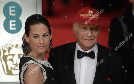 Stock Picture of Austrian Former F1 Driver Niki Lauda (r) and His Wife Birgit Wetzinger (l) Arrive on the Red Carpet For the 2014 Ee British Academy Film Awards Ceremony at the Royal Opera House in London Britain 16 February 2014 the Ceremony is Hosted by the British Academy of Film and Television Arts (bafta) United Kingdom London