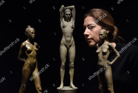 A Bonham's Staff Looks Over Robert Graham's 'Christine' (1993) Sculptures During the Lauren Bacall Collection Sale at Bonham's in London Britain 13 February 2015 the Artwork is Expected Fetch 50 000-75 000 Euros at an Auction in New York on 31 March United Kingdom London