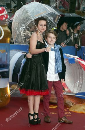 British Actress Madeleine Harris (l) and Compatriot Actor Samuel Joslin (r) Arrive For the World Premiere of 'Paddington' in Leicester Square in London Britain 23 November 2014 the Movie Opens in British Cinemas on 28 November United Kingdom London