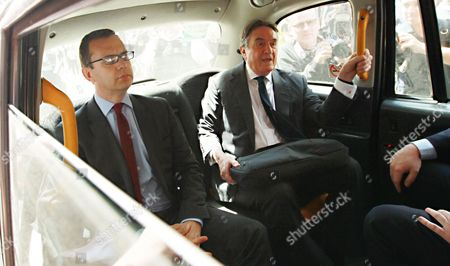 Andy Coulson Former News of the World Editor and Ex-press Secretary to British Prime Minister David Cameron Leaves in a Taxi with His Lawyer Timothy Langdale Qc From the Old Bailey Central Criminal Court in London After the Jury Were Discharged Wednesday 25 June 2014 in the Phone Hacking Trial the Jury Were Unable to Come to a Verdict in the Remaining Two Charges Against Coulson United Kingdom London