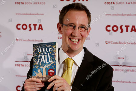 British Writer Nathan Filer Poses with His Book 'The Shock of the Fall' After Winning the Costa First Novel Award at the 2013 Costa Book Award at Quaglino's in London Britain 28 January 2014 United Kingdom London