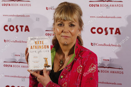 Stock Picture of British Writer Kate Atkinson Poses with Her Book 'Life After Life' After Winning the Costa Novel Award at the 2013 Costa Book Award at Quaglino's in London Britain 28 January 2014 United Kingdom London