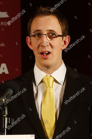 Stock Picture of British Writer Nathan Filer Reacts After Winning the the 2013 Costa Book Awards For His Book 'The Shock of the Fall' at Quaglino's in London Britain 28 January 2014 United Kingdom London