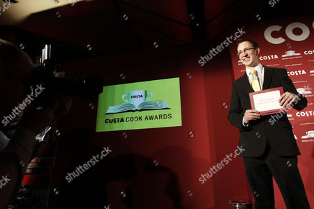 British Writer Nathan Filer Holds His Award After Winning the the 2013 Costa Book Awards For His Book 'The Shock of the Fall' at Quaglino's in London Britain 28 January 2014 United Kingdom London