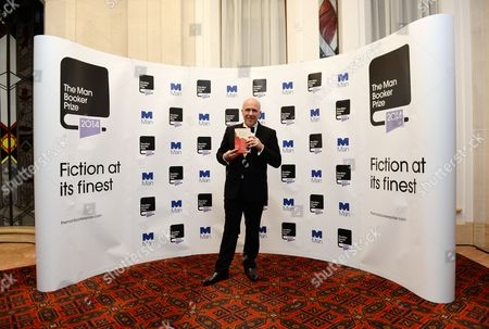 Australian Novelist Richard Flanagan Holds a Copy of His Book 'The Narrow Road to the Deep North' As He Poses As Winner of the 2014 Man Booker Prize After the Announcement Held at Guildhall in London Britain 14 October 2014 the Literary Award is Presented Annually For the Best Original Full-length English Language Novel by a Writer From the Commonwealth of Nations United States Or Ireland United Kingdom London