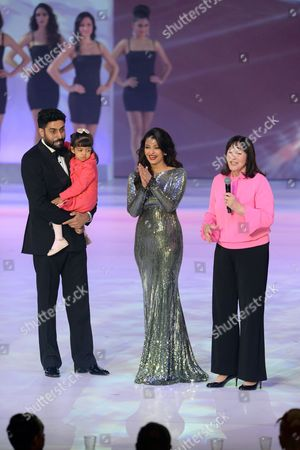 Former Miss World Aishwarya Rai (c) Speaks on Stage with Husband Abhishek Bachchan and Daughter Aaradhya Bachchan (l) During the Grand Final of the Miss World 2014 Pageant at the Excel London Icc Auditorium in London Britain 14 December 2014 United Kingdom London