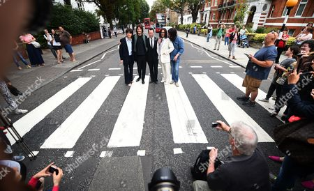 Beatles Fans Take Photographs of the Cast Members of the 'Let It Be' Musical and Actor Andrew Lancel (c) who Plays Brian Epstein Outside the Abbey Road Studios For Fans in London Britain 08 August 2014 Hundreds of Fans of the Beatles Turned out to Celebrate the 45th Anniversary of the Abbey Road Album United Kingdom London