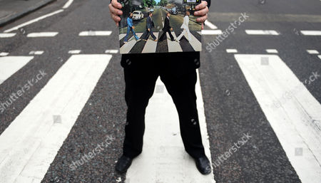 Stock Picture of British Actor Andrew Lancel who Plays Brian Epstein in the London Stage Show 'Epstein' Holds the Album of Abbey Road at Abbey Road in London Britain 08 August 2014 Hundreds of Beatles Fans Turned out to Celebrate the 45th Anniversary of Abbey Road United Kingdom London