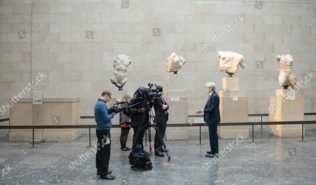 Stock Image of Sir Richard Lambert (r) Chairman of the Trustees of the British Museum Speaks to a Reporter During an Interview Next to the Parthenon Marbles Also Known As the Elgin Marbles in the British Museum in London Britain 05 December 2014 the Ilissos Statue Has Been in the British Museum Since 1816 and Has Been Loaned For First Time to the Hermitage Museum in St Petersburg's Russia Until Mid- January Greece Have Been on a Quest to Have the Parthenon Marbles Returned to Athens United Kingdom London