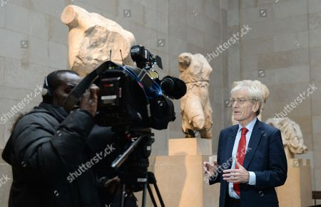 Stock Photo of Sir Richard Lambert (c) Chairman of the Trustees of the British Museum Speaks to a Reporter During an Interview Next to the Parthenon Marbles Also Known As the Elgin Marbles in the British Museum in London Britain 05 December 2014 the Ilissos Statue Has Been in the British Museum Since 1816 and Has Been Loaned For First Time to the Hermitage Museum in St Petersburg's Russia Until Mid- January Greece Have Been on a Quest to Have the Parthenon Marbles Returned to Athens United Kingdom London