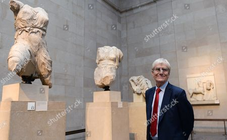 Sir Richard Lambert Chairman of the Trustees of the British Museum Stands Next to the Parthenon Marbles Also Known As the Elgin Marbles in the British Museum in London Britain 05 December 2014 the Ilissos Statue Has Been in the British Museum Since 1816 and Has Been Loaned For First Time to the Hermitage Museum in St Petersburg's Russia Until Mid- January Greece Have Been on a Quest to Have the Parthenon Marbles Returned to Athens United Kingdom London
