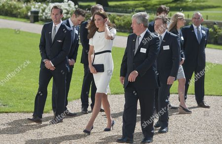 Britain's Catherine (2-l) Duchess of Cambridge and Compatriot Olympic Medalist Sir Ben Ainslie (l) Walk with Sir Keith Mills (2-r) of the London Organising Committee of the Olympic Games and British Entepreneur Sir Charles Dunstone (r) at the Royal National Maritime Museum in Greenwich London 10 June 2014 the Duchess Attended a Reception to Announce a British Bid For the America's Cup in 2017 United Kingdom London