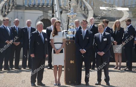 Britain's Catherine (2-l) Duchess of Cambridge and Compatriot Olympic Medalist Sir Ben Ainslie (2-r) Sir Keith Mills (l) of the London Organising Committee of the Olympic and Paralympic Games and British Entepreneur Sir Charles Dunstone (r) Pose with the America's Cup at the Royal National Maritime Museum in Greenwich London 10 June 2014 the Duchess Attended a Reception to Announce a British Bid For the America's Cup in 2017 United Kingdom London