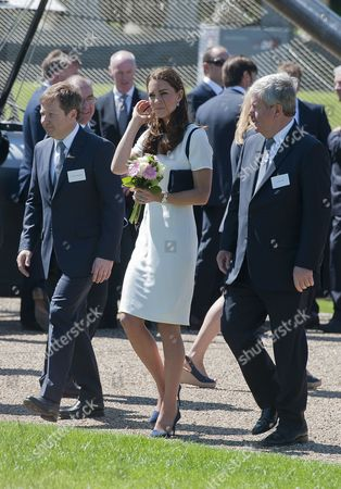 Britain's Catherine (c) Duchess of Cambridge Sir Keith Mills (r) of the London Organising Committee of the Olympic Games and British Entepreneur Sir Charles Dunstone (l) Walk at the Royal National Maritime Museum in Greenwich London 10 June 2014 the Duchess Attended a Reception to Announce a British Bid For the America's Cup in 2017 United Kingdom London