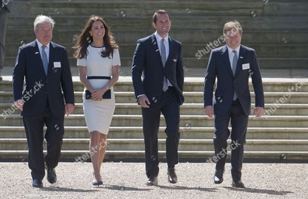 Britain's Catherine (2-l) Duchess of Cambridge and Compatriot Olympic Medalist Sir Ben Ainslie (2-r) Sir Keith Mills (l) of the London Organising Committee of the Olympic and Paralympic Games and British Entepreneur Sir Charles Dunstone (r) Walk at the Royal National Maritime Museum in Greenwich London 10 June 2014 the Duchess Attended a Reception to Announce a British Bid For the America's Cup in 2017 United Kingdom London
