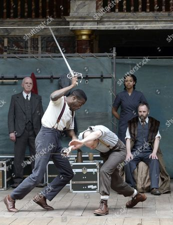 Actors Nigerian-born Ladi Emeruwa (front-l) As Hamlet and British John Dougall (front-r) As Claudius Perform During a Rehearsal at the Shakespeare Globe Theatre in London Britain 23 April 2014 the Play 'Globe to Globe Hamlet' Directed by Dominic Dromgoole Will Travel For the Next Two Years to 205 Countries in the World to Stage Hamlet on the Occasion of the 450th Birth Anniversary of Shakespeare United Kingdom London