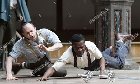 Stock Picture of Actors Nigerian-born Ladi Emeruwa (r) As Hamlet and British John Dougall (l) As Claudius Perform During a Rehearsal at the Shakespeare Globe Theatre in London Britain 23 April 2014 the Play 'Globe to Globe Hamlet' Directed by Dominic Dromgoole Will Travel For the Next Two Years to 205 Countries in the World to Stage Hamlet on the Occasion of the 450th Birth Anniversary of Shakespeare United Kingdom London