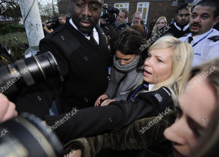 Elisabetta Grillo (centre Left Scarf Around Face) Besieged by the Media After She and Her Sister Francesca (not in Picture) Were Found not Guilty of Defrauding British Television Celebrity Chief Nigella Lawson and Her Former Husband Charles Saatchi at Isleworoth Crown Court in London 20 December 2013 the Sisters Had Been Accused of Stealing Almost 700 000 Pounds Sterling (euros 840 000) United Kingdom London