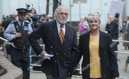 British Dj Dave Lee Travis (c) and His Wife Marianne Griffin (r) Depart Southwark Crown Court in London Britain 26 September 2014 Veteran Bbc Television and Radio Presenter Dave Lee Travis was Sentenced to Three Months For Indecent Assault Relating to an Incident in 1995 United Kingdom London