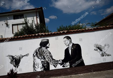 A Picture Made Available on 31 August 2016 Shows a Wall Painting Depicting Libya's Ousted Dictator Colonel Muammar Gaddafi Shaking Hands with Us President Barack Obama During the Mural Festival in the Village of Staro Zhelezare Some 14km From Sofia Bulgaria 30 August 2016 the Project was Initiated by the Artistic Duo Katarzyna and Ventzi Piryankova Based in Poznan Poland the Festival 'Village of Personalities / Art For Social Change' Started in 2013 and Since Then There Are 53 Paintings on the Walls of the Village Representing Local People in the Company of Celebrities From Politics and Culture Bulgaria Staro Zelezare