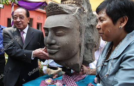 Cambodian Foreign Minister Hor Namhong (l) and Pheoung Sackona (r) Minister of Culture and Fine Arts Pose For the Pictures Next to Brahma Head Statues During a Ceremony at the National Museum in Phnom Penh Cambodia 30 March 2016 the Cambodian National Museum Received Two Brahma Head Statues From France After They Were Stolen From the Koh Ker Archaeological Site in the Cambodian Preah Vihear Province During the Civil War in the 1970's Cambodia Phnom Penh