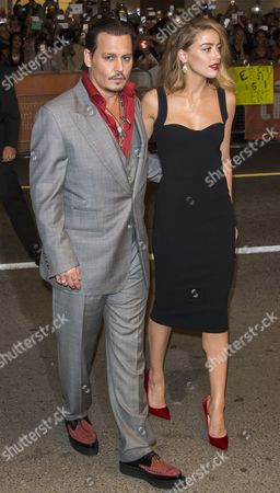 Us Actor and Cast Member Johnny Depp (l) and His Wife Amanda Heard Arrive For the Screening of the Movie 'Black Mass' During the 40th Annual Toronto International Film Festival (tiff) in Toronto Canada 14 September 2015 the Festival Runs From 10 to 20 September Canada Toronto