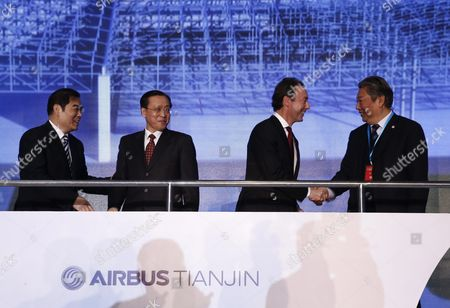 (l-r) Tianjin Vice-mayor Duan Chunhua (l) and National Development and Reform Commission Vice-minister Lin Nianxiu (2-l) Look on As Airbus President and Ceo Fabrice Bregier (3-l) and Aviation Industry Corporation of China President Lin Zuoming (r) Greet Each Other During a Ground-breaking Ceremony For an A330 Completion and Delivery Center at Airbus Tianjin Facilities in Tianjin Municipality China 02 March 2016 the Facility Will Be Installing Cabins and Furnishing and Conduct Exterior Painting in Airbus Aircraft Coming From Its Assembly Line in France China Tianjin