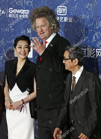 Tiantan Award Jury Members (l-r) Chinese Actress Xu Qing German Director Florian Henckel Von Donnersmarck and Japanese Director Takita Yojiro Arrive For the Opening Ceremony Red Carpet Event of the 6th Beijing International Film Festival at the Beijing Yanqi Lake International Convention and Exhibition Center in Beijing China 16 April 2016 the Film Festival Runs From 16 to 23 April China Beijing