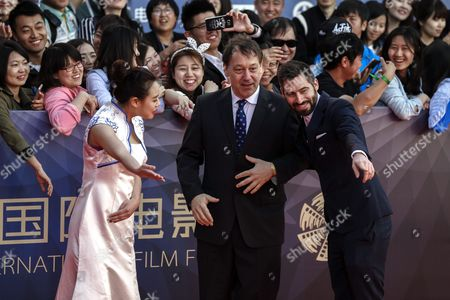 Us Film Director Sam Raimi (c) Arrives For the Closing Ceremony Red Carpet Event of the 6th Beijing International Film Festival at the Beijing Yanqi Lake International Convention and Exhibition Center in Beijing China 23 April 2016 the Film Festival Ran From 16 to 23 April China Beijing