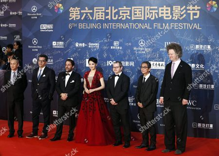 Tiantan Award Jury Members (l-r) Hong Kong Director Teddy Chan Bosnian Director Danis Tanovic Us Director Brett Ratner Chinese Actress Xu Qing Romanian Director Corneliu Porumboiu Japanese Director Takita Yojiro and German Director Florian Henckel Von Donnersmarck Arrive For the Closing Ceremony Red Carpet Event of the 6th Beijing International Film Festival at the Beijing Yanqi Lake International Convention and Exhibition Center in Beijing China 23 April 2016 the Film Festival Ran From 16 to 23 April China Beijing